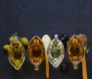 Различные типы постного масла - сезама, оливки, льняного семени Стоковые Изображения RF