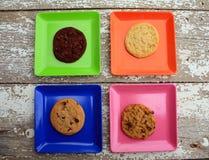 Различный покрашенный квадрат 4 с плитами с печеньями Стоковые Фото
