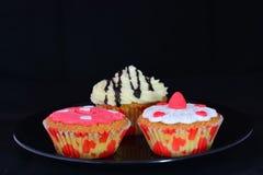 Различный тип очень вкусных пирожных изолированных на черной предпосылке Стоковая Фотография RF