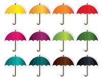 12 различных зонтика в 12 других цветах на дождливый день иллюстрация вектора