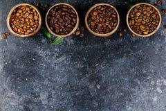4 различных разнообразия кофейных зерен Стоковое Изображение RF