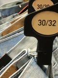 Размеры Джина на шкафе Стоковая Фотография