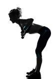разминка женщины веса тренировки позиции пригодности Стоковое фото RF