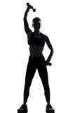 разминка женщины веса тренировки позиции пригодности Стоковые Изображения