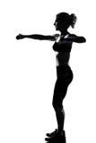 разминка женщины веса тренировки позиции пригодности Стоковая Фотография RF