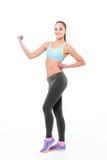 Разминка женщины фитнеса с гантелями Стоковое Фото