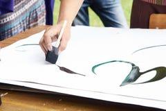 Разминка каллиграфии на белой бумаге Стоковая Фотография RF