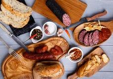 Разнообразие салями, chechil сыра и хлеба стоковая фотография rf