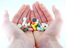 Разнообразие таблетки в руках Стоковое Фото