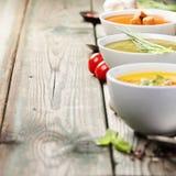 Разнообразие cream супов над старой деревянной предпосылкой Стоковые Фотографии RF