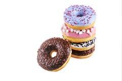 Разнообразие donuts при замороженность изолированная на белизне Стоковое Фото