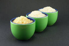 разнообразия зеленого риса чашек малые 3 Стоковые Фото