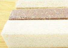 Разнообразия риса: коричневый рис, красный рис груза, белый рис Стоковые Изображения
