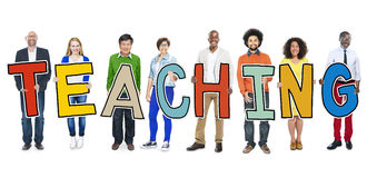 Разнообразная группа людей держа преподавательство текста стоковое изображение rf