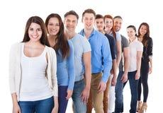 Разнообразная группа людей стоя в строке Стоковое фото RF