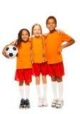 Разнообразная смотря футбольная команда изолированная на белизне Стоковая Фотография