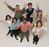 разнообразная этнически группа вручает счастливое поднимающее вверх Стоковое фото RF
