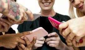 Разнообразные люди используя цифровые приборы Стоковая Фотография