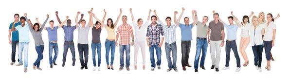 Разнообразные люди в вскользь празднуя успехе Стоковые Изображения