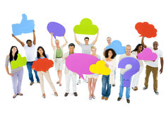 Разнообразные люди держа красочный пузырь речи Стоковая Фотография