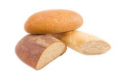 Разные виды хлеба на светлой предпосылке Стоковые Изображения
