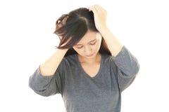 Разочарованная азиатская женщина Стоковые Фото