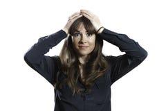 Разочарованные женские модельные руки на предпосылке изолированной головой белой Стоковое фото RF