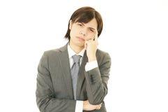 Разочарованный азиатский бизнесмен стоковое фото rf
