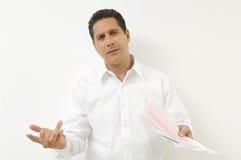 Разочарованный человек с документами Стоковое фото RF