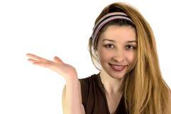 разрекламируйте милое удерживание что-то женщина Стоковая Фотография RF