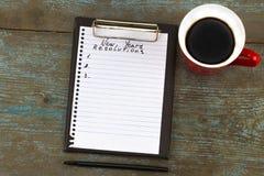 Разрешение ` s Нового Года написанное на блокноте и ручке Новый Год res Стоковые Фотографии RF