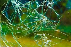 Разрушенное окно с красочной предпосылкой Стоковые Изображения