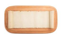 Разделочная доска и пергамент на белизне Стоковые Фото