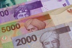 Различная индонезийская рупия на таблице Стоковое Фото