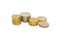 Различное штабелированное евро чеканит на светлой предпосылке Стоковые Изображения RF