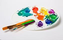 Различные кисти и цветовая палитра размера стоковые фото
