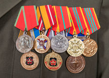 Различные награды и медали на форме Стоковое фото RF