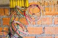 Различные покрашенные кабели для установки выхода силы в constr Стоковые Фото