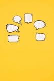 Различные пустые пузыри речи изолированные на желтой предпосылке Стоковые Изображения