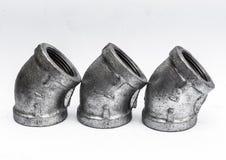 Различные штуцеры металла внутренние, для труб на белизне Стоковое Изображение RF