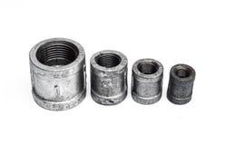 Различные штуцеры металла внутренние, для труб на белизне Стоковые Фото