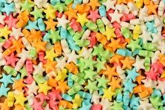 Различный цвет конфеты играет главные роли предпосылка Стоковая Фотография RF