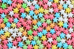 Различный цвет конфеты играет главные роли предпосылка Стоковая Фотография