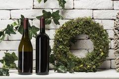 2 различных бутылки красных вина на белизне Стоковые Фото
