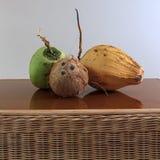 3 различных кокоса на таблице Стоковое фото RF