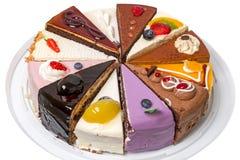 12 различных кусков пирога на плите Стоковое фото RF