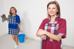 2 различных уборщика состязаются плохой штат Стоковая Фотография