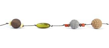 4 различных этнических шарика в ожерелье Стоковое Изображение RF