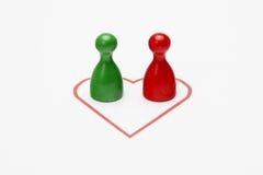 2 различных figurines в сердце Стоковые Фотографии RF