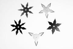 5 различных shurikens Стоковые Фотографии RF